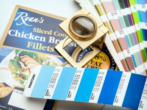Pantone book and eye glass with printed food packaging