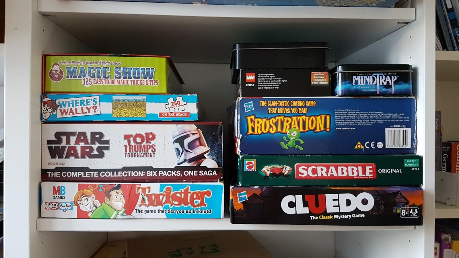 toys and game boxes stored on a shelf